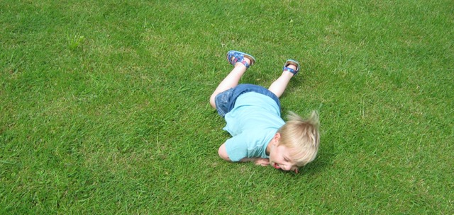 Child rolling and laughing
