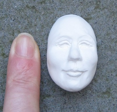 Tiny plaster face cr Lizzie Morris