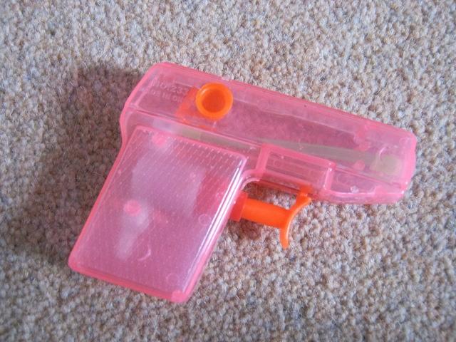 Pink water pistol cr Judy Darley