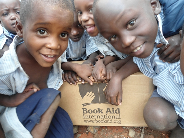 NSCRC children with Book Aid box
