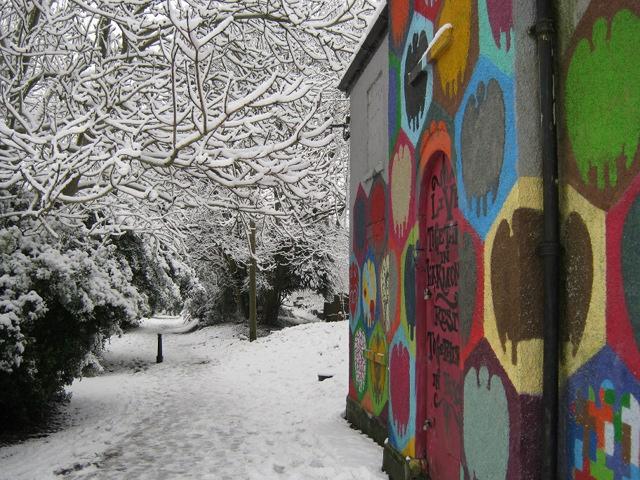 Snowy cemetery graffiti cr Judy Darley