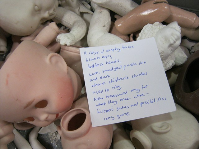 Doll heads poem cr Judy Darley