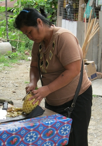 Woman preparing pineapple, Borneo cr Judy Darley