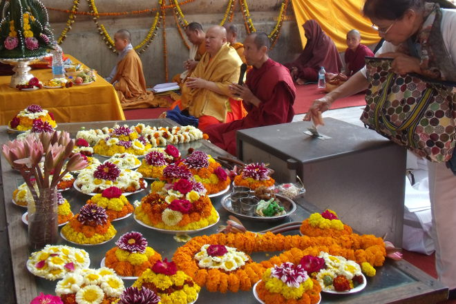 Buddhist monks and offerings cr Dipika Mukherjee