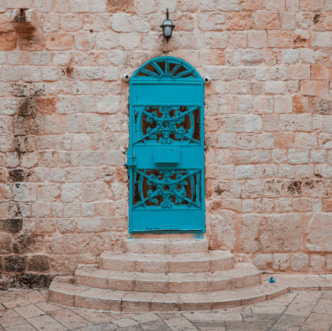 Blue door, Israel. Photo by Josh Appel on Unsplash