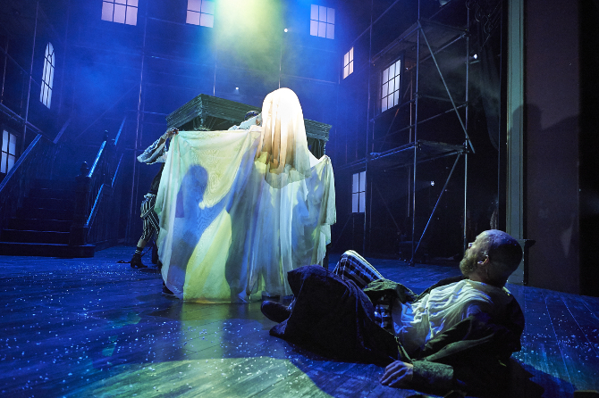 Ensemble and Felix Hayes as Scrooge in A Christmas Carol at Bristol Old Vic, credit Geraint Lewis