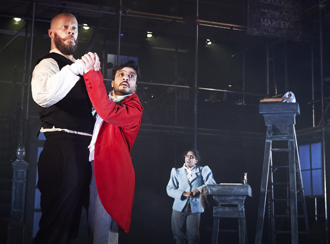 Felix Hayes, Saikat Ahamed and Nadia Nadarajah in A Christmas Carol at Bristol Old Vic, credit Geraint Lewis