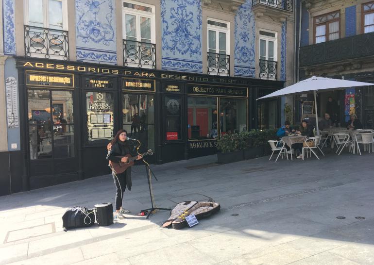 Porto busker on Rua das Flores by Judy Darley
