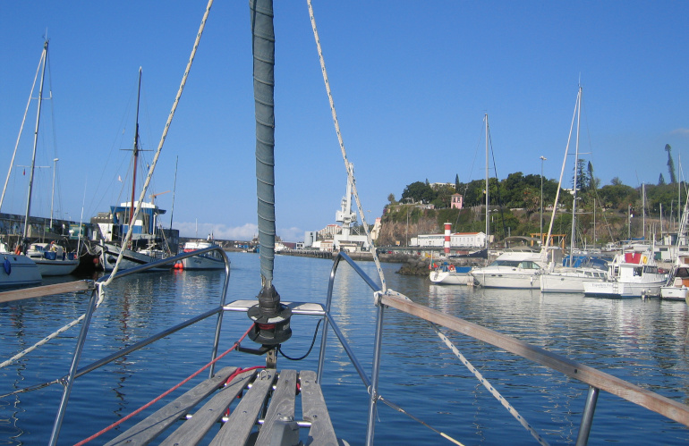 Breathing Water by Judy Darley. View of harbour from prow of boat.