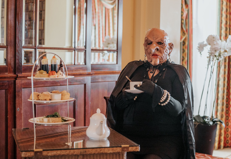 TravMedia_United_Kingdom_1474398_The_Grand_High_Witch_enjoying_a_Witches_Afternoon_Tea_at_The_Headland_Hotel